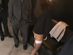 Raunchy cutie in black dress stands on knees and sucks cock